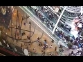 Hong Kong shoppers injured when escalator goes into reverse – video